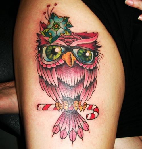 A pink owl tat
