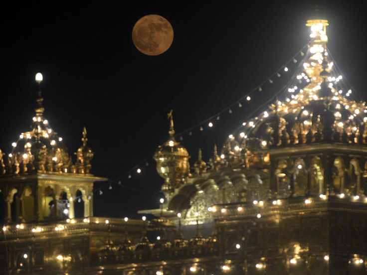 The 'supermoon' rises over the Sikh Shrine, the Golden Temple in Amritsar on November 14, 2016. Picture: AFP PHOTO / NARINDER NANU