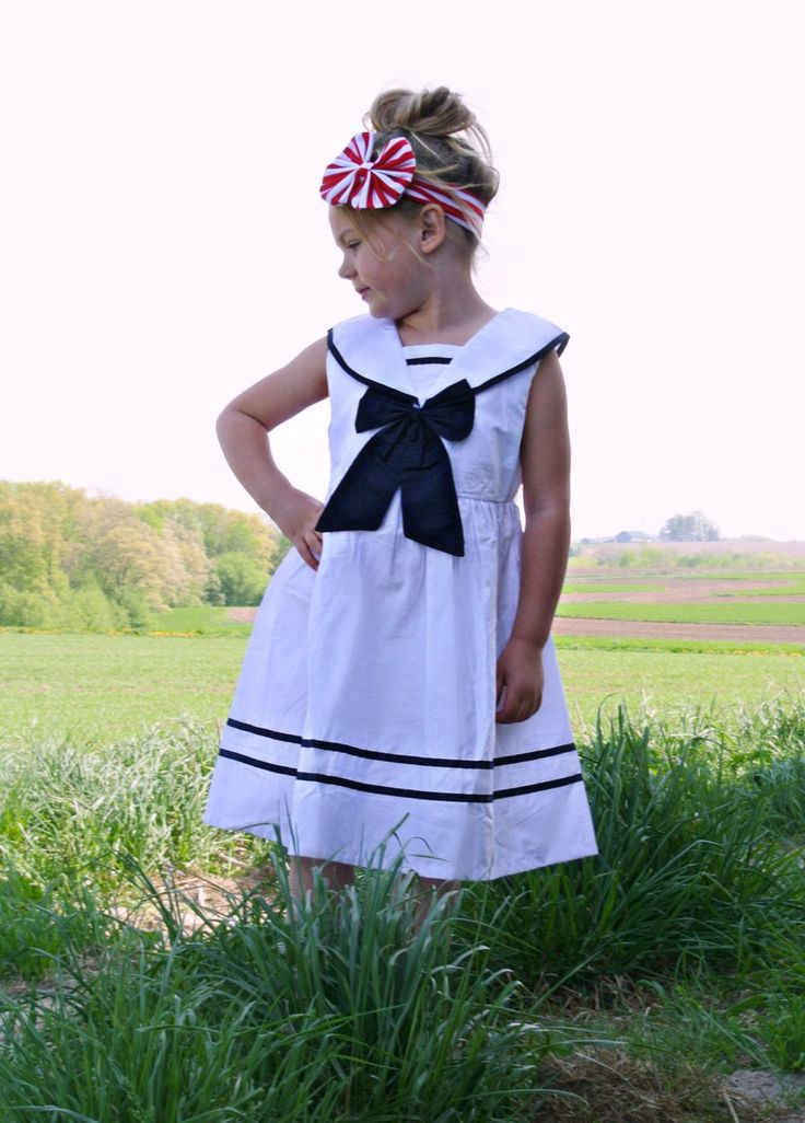 Classic sailor dress for your little princess. Made of cool summer weight cotton and has navy blue piping. Zips in back. Pefect for summer and into back-to-school.