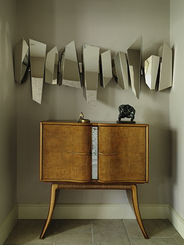 Although these mirrors are a hard DIY to fix, I figure this would be really nice on a smaller scale with some pictures or illustrations on sturdy paper, tacked to the wall with blu tack!