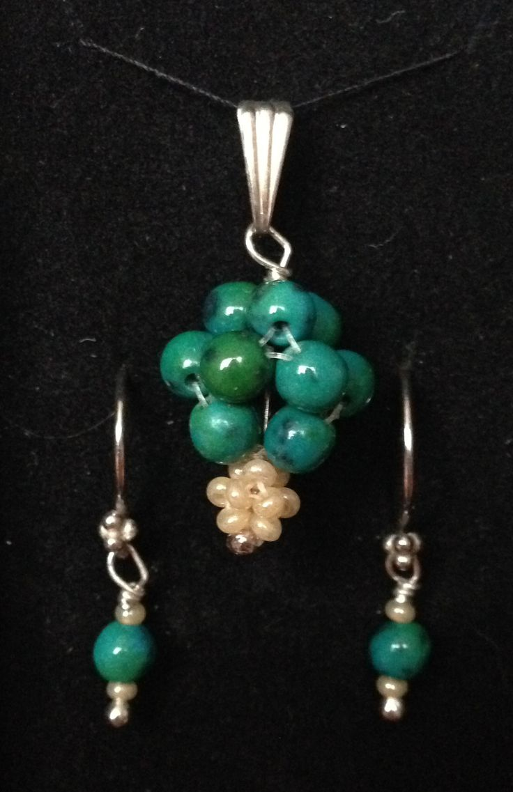 Set of earrings and pendant made of two kinds of beads and silver.