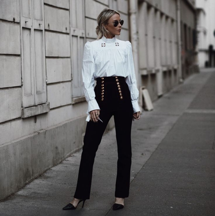 PFW SS2017 | Happily Grey. White Victorian style blouse+black high-waist pants with golden buttons+black pumps+sunglasses. Fall Outfit 2016