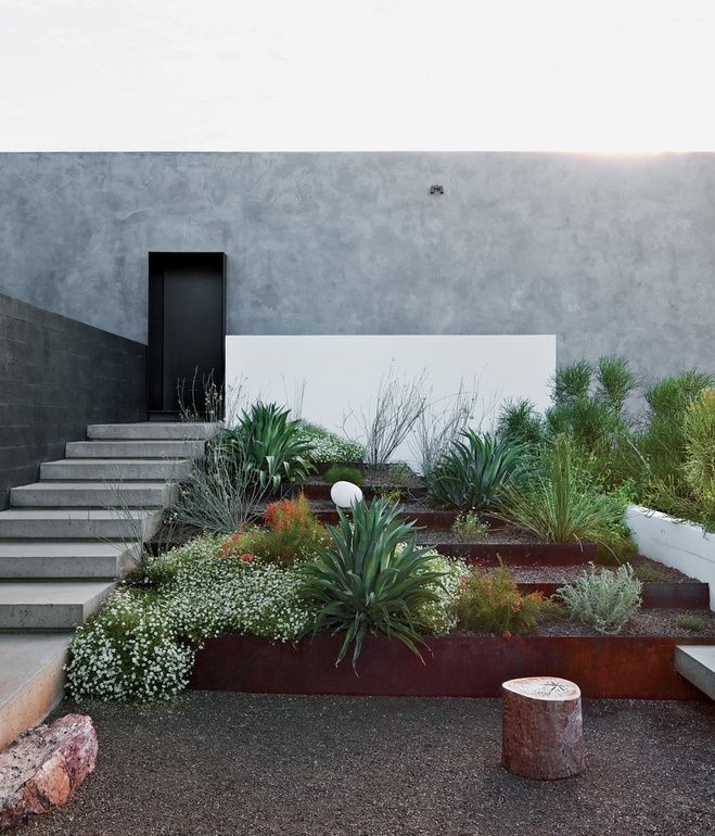 Concrete stairs factor into the landscaping surrounding a modern house in Phoenix, Arizona. Photo by: Dean Kaufma