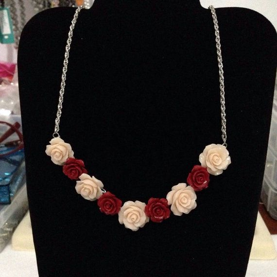 Check out this item in my Etsy shop https://www.etsy.com/listing/212559234/red-and-cream-coral-flower-necklace