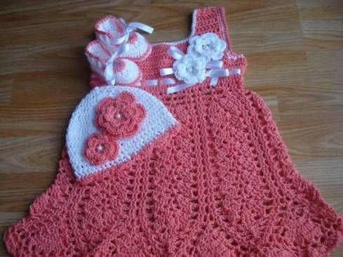 crochet baby dress with hat and shoes and flower embellishments
