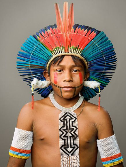 Kayapo Portraits | BEPRÔ wears the beads and cotton-wrapped earrings that boys receive as part of their naming ceremony. | ©Martin Schoeller