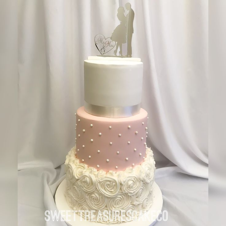 3 tier wedding cake decorated with buttercream swirls and pearls.  #sweettreasures #sweettreasurescakeco #weddingcake #3tier #cake #mrsandmrs #pearls #wedding #marriage #bae #whiteandpink #caketopper #celebrations #celebrationcakes #johannesburg #southafrica