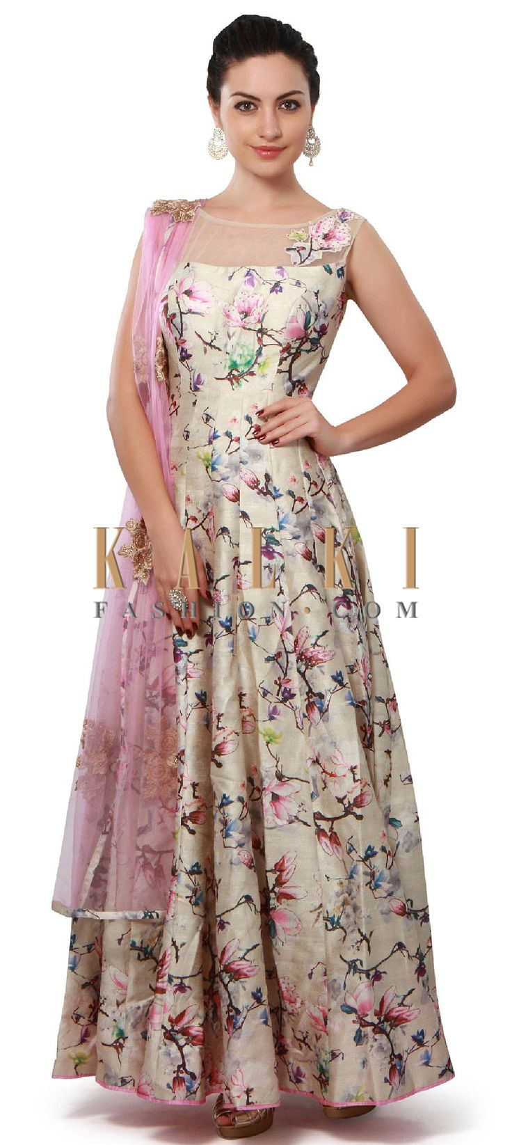 Buy Online from the link below. We ship worldwide (Free Shipping over US$100). Product SKU - 313605. Product Price - $299.00. Product link - http://www.kalkifashion.com/cream-anarkali-suit-enhanced-in-print-and-applique-embroidery-only-on-kalki.html