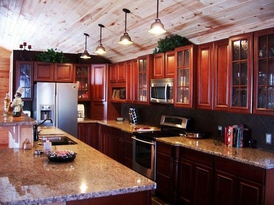 Love the glass cabinets wood on ceiling and hanging for Gambrel barn plans with living quarters