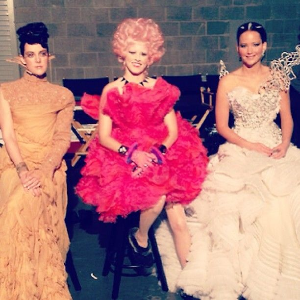 Jena Malone, Elizabeth Banks, and Jennifer Lawrence behind the scenes of Catching Fire