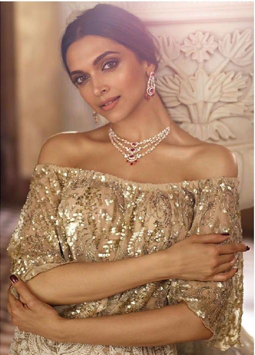 Deepika Padukone reigns in this shimmery cape by JADE for a Tanishq AD. Her sophisticated look has been styled by the talented Shaleeena Nathani #deepikapadukone #jadecouture #monicakarishma