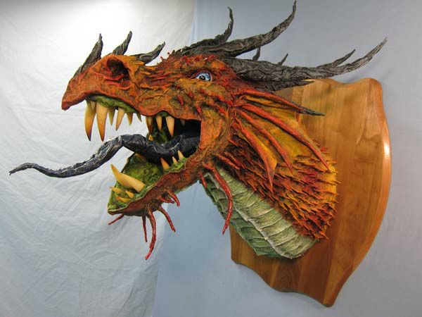 Dan Reeder's new paper mache dragon trophy | also a very popular video showing the making of this sculpture