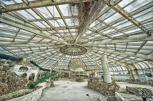 Tropicana, the abandoned swimming pool: the main swimming pool   This swiming pool in Rotterdam was closed down in 2010. Now there are some small businesses but the rest of the pool is relatively neglected.In the pool area there are no longer bathing guests, but dead plants and left furniture.  Lens used: Sigma 12-24mm Enhanced with Nik HDR Efex Pro2