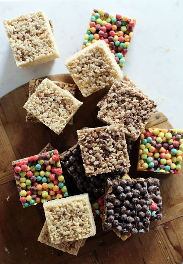 Marshmallow Cereal Bars using Trix, Cocoa Poufs, and Rice Crispie cereals.