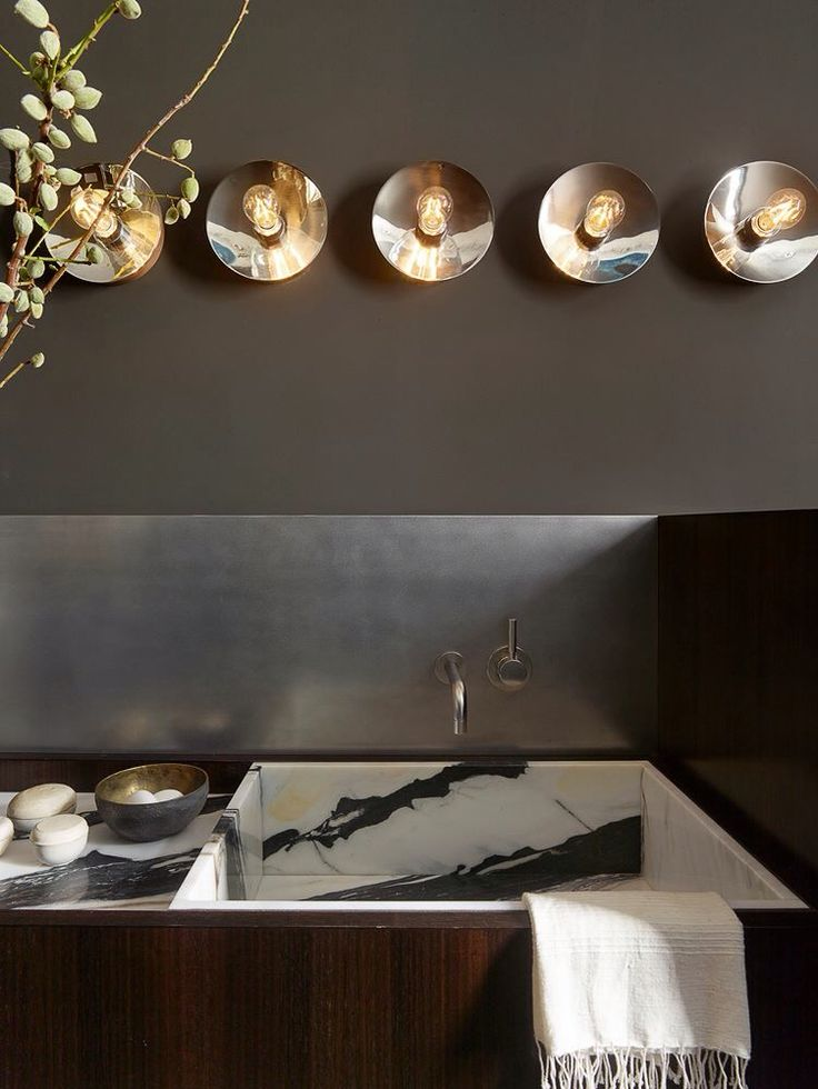 Stunning inset marble sink design. By Martin Group Interior Architecture & Design.