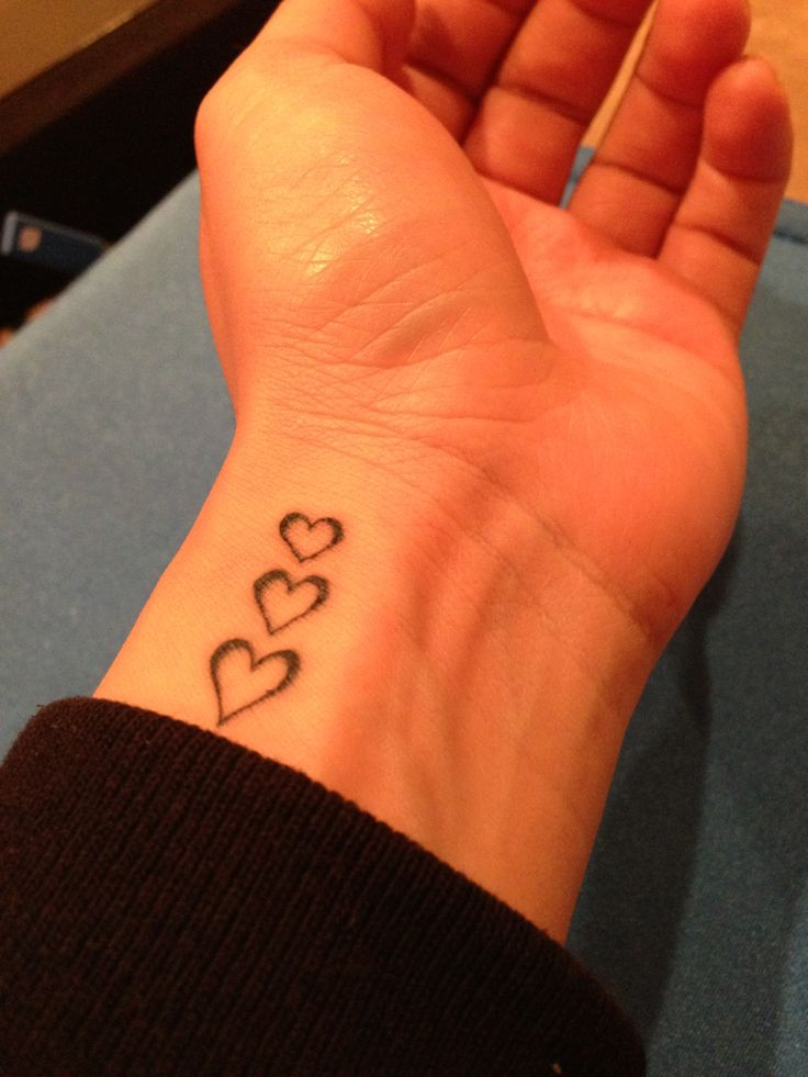 "Hearts in a row. Tattoo on wrist. Maybe with the word ""love"" next to it??"