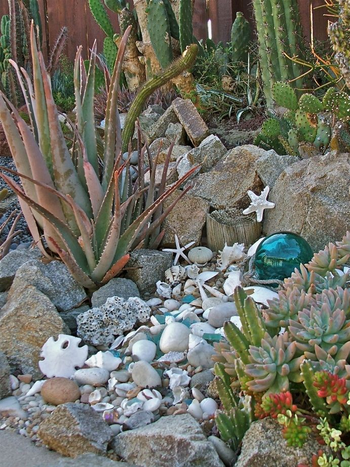 Seashells in the garden i do this too grandma did as for Beach garden designs
