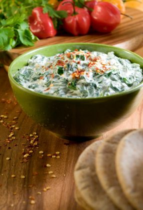Spinach Dip - It may look like it, but this is not the heavy, fat-laden spinach dip you grew up eating out of bread bowls. Our version has only 3 grams of fat per serving, plus healthy fiber and protein. #BigGame #TeamBeachbody