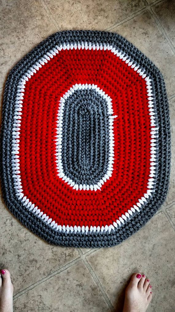 Ohio State inspired Crochet Block O Decorative Rug! Unique addition to any Buckeye collection!  Rug is crocheted using 100% acrylic yarn that is machine washable and dryable. Rug measures about 24 x 30 inches.  Larger version of the Block O Rug available here: https://www.etsy.com/listing/242538728/ohio-state-rug-ohio-state-crochet-rug  Set of 2 Block O Rugs: https://www.etsy.com/listing/267209089/ohio-state-crochet-rug-set-osu-buckeye  Please visit my Etsy Shop here…
