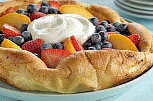 Bake large popover-like Dutch Baby Pancakes in a pie plate and fill with fresh fruit. Top Dutch Baby Pancakes with sweetened cream cheese and serve.