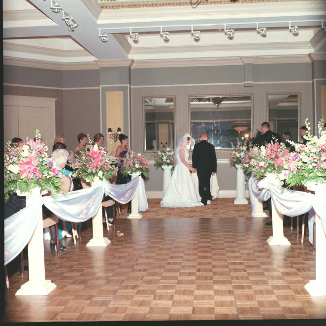 A great way of decorating your aisle is to use the table centerpieces like we did at Harry's Savoy Ballroom.