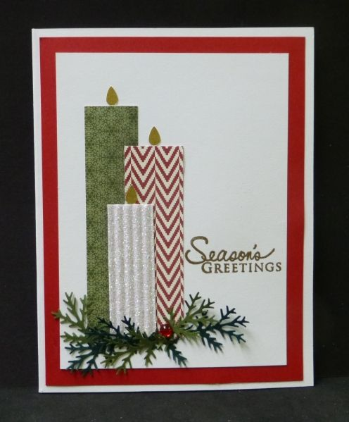 By hobbydujour at Splitcoaststampers. Christmas card. Uses designer paper for candles. Flames from tear drop punch. Holly leaves from Martha Stewart fern punch. Gem for holly berry. PTI sentiment. Easily mass-produced.