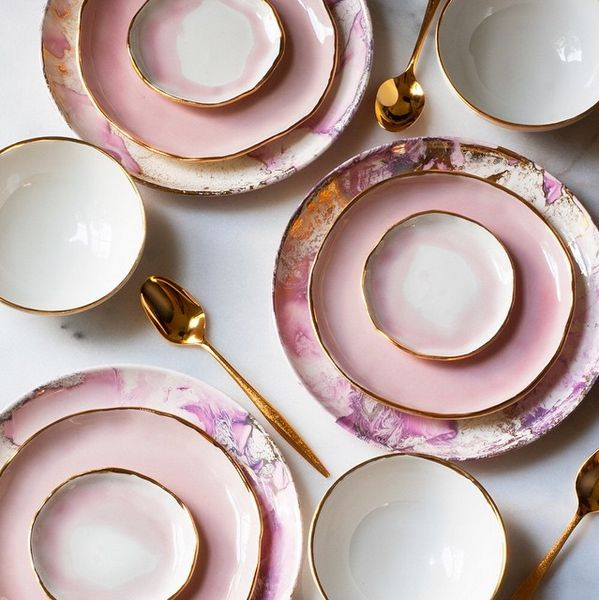 Pretty much the prettiest pink plates and gold silverware ever. These as salad or dessert plates on top of larger white ones would be fabulous.