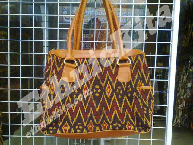 Ethnic Woven Leather Bag Flores is combination between Flores Woven and Leather.   East Nusa Tenggara.    Measurements : Height: 29cm x Width: 33cm x Thickness 15cm   Material : Flores Woven and Leather   Motif : Red zig-zag line with diamond dot   Ethnic Of : Flores, NTT    Description :  - Regioal Origin: Flores, Nusa Tenggara Timur, Indonesia