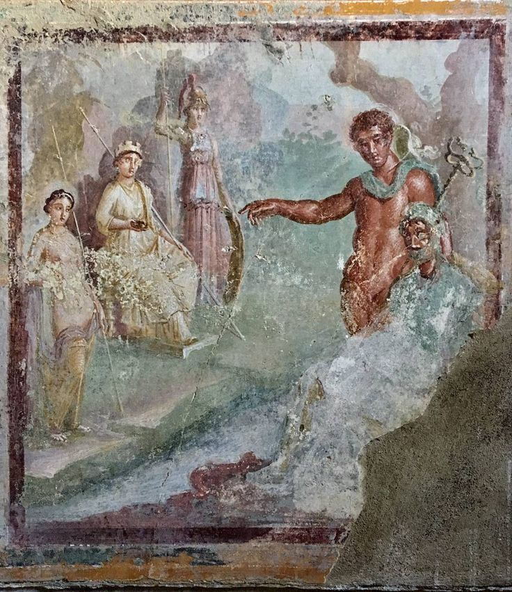 The fresco depicts the Judgement of Paris: The Trojan prince stands next to Mercury, pointing at the chosen goddess  depicted on the opposite wall with the other two goddesses.  House of Venus in a Bikini. Pompeii