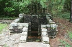 Ouachita National Forest - Horse Thief Spring Historic Site. Now surrounded by a stone enclosure, Horse Thief   Spring is located in the Ouachita National Forest   along the Oklahoma section of the Talimena Drive.