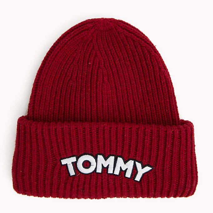 3924ef87e7490e ShopStyle Collective This snug-fitting ribbed beanie hat has a striking  Tommy Hilfiger patch logo on the turn-up cuff. Highlights Acrylic blend  All-over ...