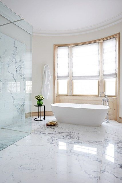 In this cavernous bathroom decoration has been kept to a minimum, to create  a serene
