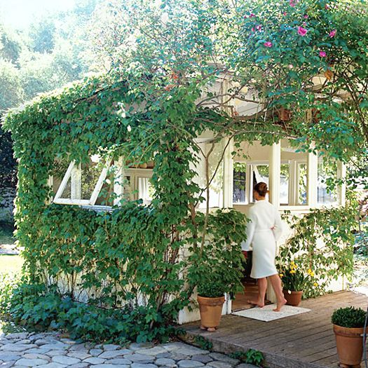 an ivy covered studio in the back