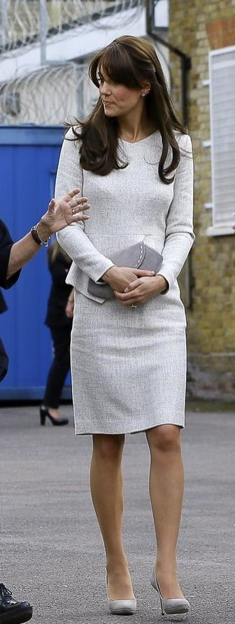 Kate Middleton wore a light grey peplum dress: