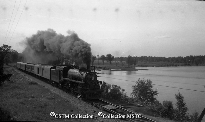 Along side the Ottawa River with the Pembroke local train. Sand Point August 1958