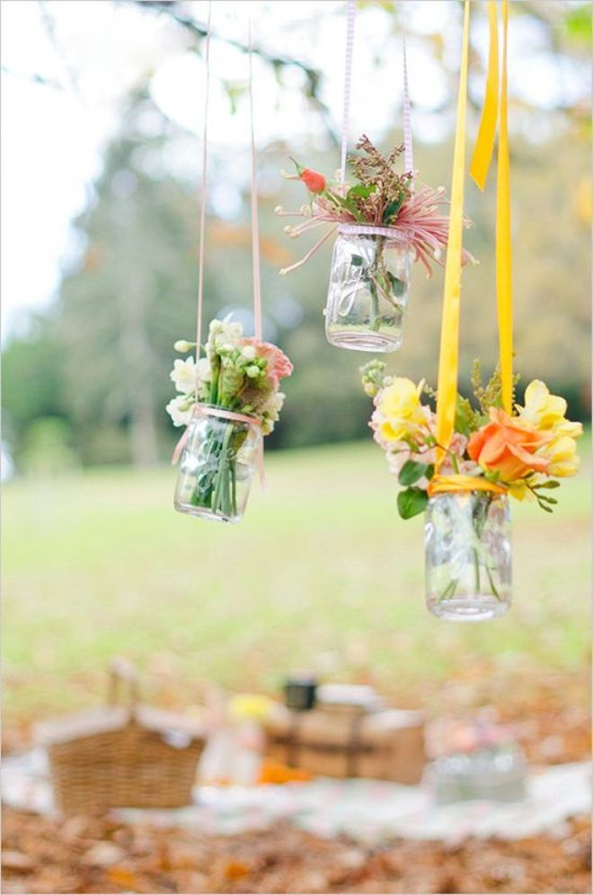 Pretty garden decor. Hang your flowers from your tree branches using a sturdy ribbon. Good party idea too.