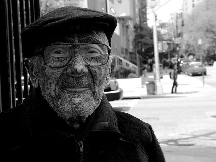 Old man tattooed face
