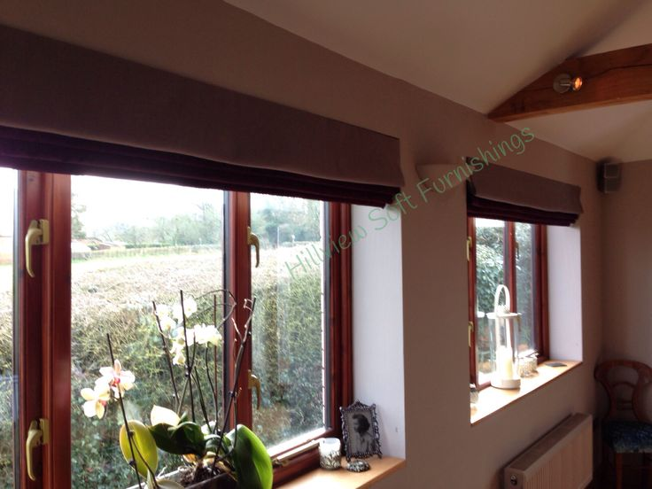 Faux roman blinds in linen and crushed velvet for a luxurious look..