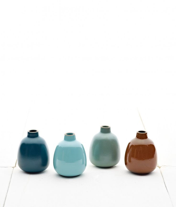 <p><span>A classic gift set, our four bud vases in the elegant Deep Teal, bright Aqua Gloss, subtle and semi-matte Juniper, and richly glossy Bourbon (left to right) will make any space a little more cozy.</span></p> <p><span>Inspired by verdant Northern California, our glazes this season capture the quiet tranquility of the forest. This collection's only available for a limited time, but you'll love what you find for years to come. </span></p>