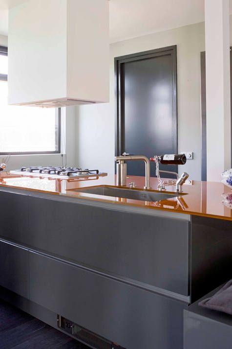 steel grey units and orange glass worktop