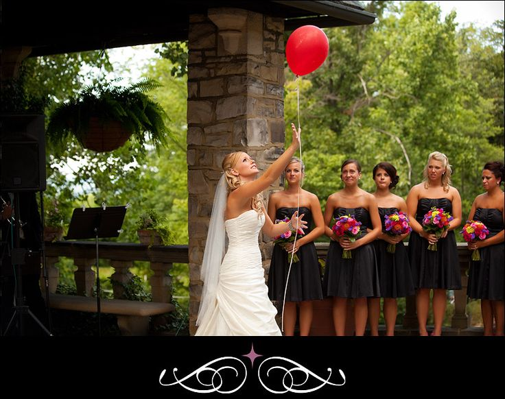 DOING THIS ... The bride writes a message to her loved ones in heaven and releasing a balloon into the sky for them.