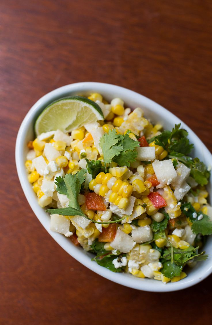 Healthy Roasted Corn and Cilantro Salad with Sweet Corn, Red Pepper, Jicama, Jalapeño, Cilantro, Lime, Olive Oil, Queso Fresco or Cajita, Chili Powder- or Cumin, Cayenne, and Salt and Pepper to taste. If you don't have good Mexican hard cheeses available to you, Feta is an OK substitution. In an absolute dire strait, you can use grated Parmesan cheese. Delicious, Tasty, and Filling!