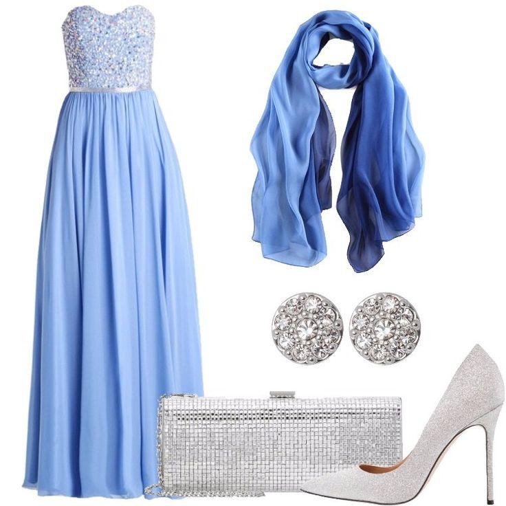 L'outfit è composto da un abito lungo da sera, un paio di tacchi argentati a punta, una pochette argentata, una sciarpa in seta e da un paio di orecchini.