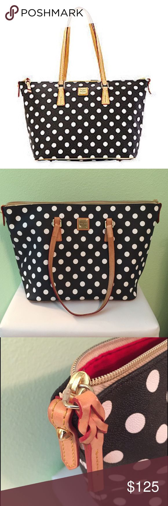 """Used Dooney & Bourke polka dot shopper Used Dooney & Bourke polka dot shopper, great condition. I bought this bag new for over $200. This was my daily carry for about 6 months. In great condition, has some staining on the interior (I have a toddler, it happens) but no noticeable exterior flaws. Tons of room!Top zip closure. Interior zip, wall and cell-phone pockets. Protective metal feet. PVC/cotton. By Dooney & Bourke.                      13""""W x 11""""H x 6""""D. (Interior capacity: large.) 9""""…"""