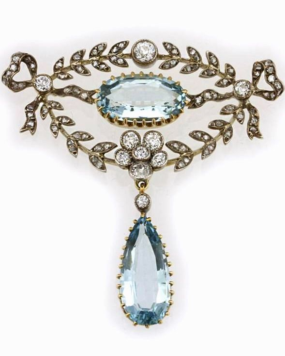 A LATE VICTORIAN AQUAMARINE AND DIAMOND LAUREL BROOCH the brooch set with an oval-shaped faceted aquamarine, set to the centre of a delicate open diamond surround of laurel garlands, ribbon ties and foliate motifs, suspending a pear-shaped aquamarine drop, the yellow gold-set aquamarines estimated to weigh a total of 6.8 carats, the diamonds estimated to weigh a total of 1.3 carats, all set in silver to a yellow gold mount, circa 1890