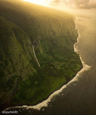 High flying along the luscious cliffs of Kohala's rugged coastline and valleys. Late afternoon light breaks through the clouds as our @paradisehelicopters' pilot makes a bank turn over endless waterfalls.