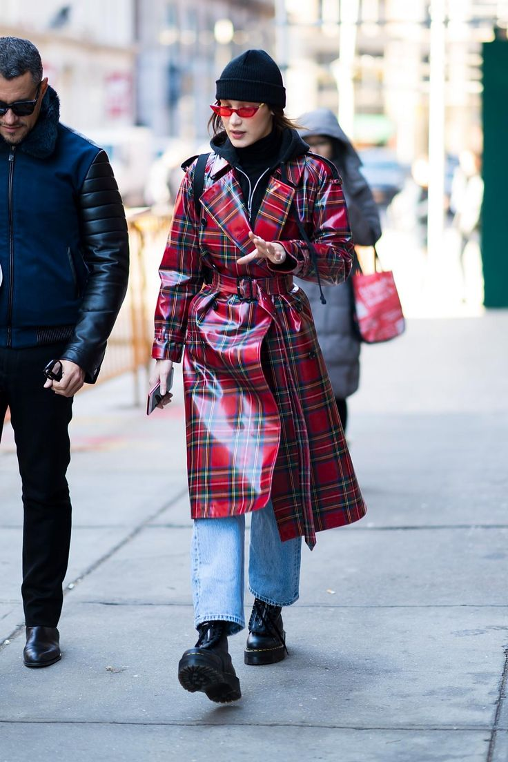 Bella Hadid wearing Burberry Laminated Tartan Wool Trench Coat in Bright Red, Dr. Martens X Lazy Oaf Jungle Boots, Poppy Lissiman Le Skinny Sunglasses in Strawberry and Prada Nylon and Leather Belt Bag
