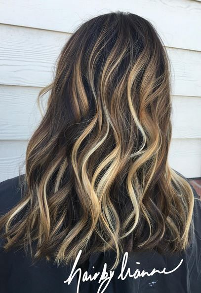 Yes – brunettes you can go this blonde via highlights and still look blended. Get the look via balayage. Color by Leanne Deaderick.