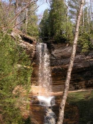 Munising Falls is in Munising, off of H-58.  From downtown Munising,head east on H-58.  Take a left on Sand Point Rd.  There is a sign. Munising Falls is in   At the falls there is a parking area, and restrooms. It is a short walk to the falls.