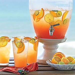 "Seaside Sunrise. Sip your coffee my little darlings while I tell you the ingredients to this ""it's a winner"" cocktail. Pineapple juice, orange-mango juice, passion fruit-flavored rum, cranberry juice, grenadine, & sparkling wine. I'll see you on the beach."